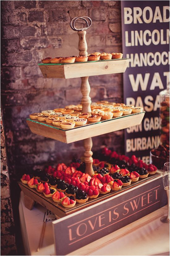 a simple wooden tiered stand with glass on top is ideal for a retro or vintage rustic wedding, add tags or signs to it