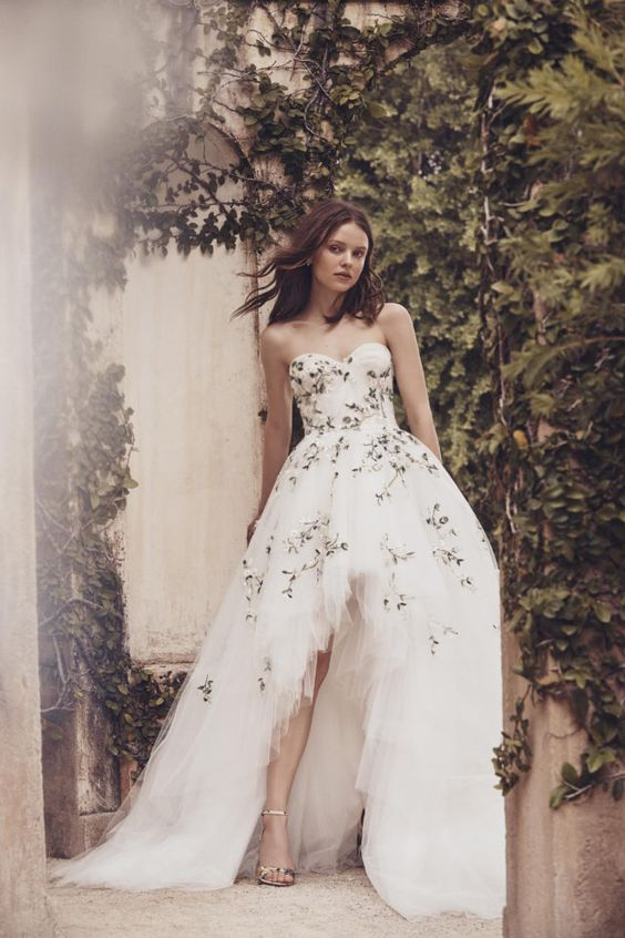 a strapless floral wedding ballgown with green embroidery, with a layered tulle skirt with a train is a chic and bold idea