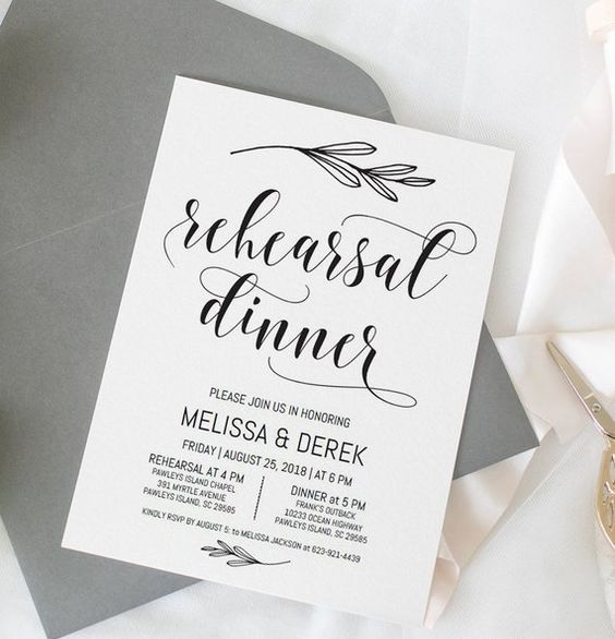 a stylish and simple black and white rehearsal dinner invitation with botanicals and a grey envelope