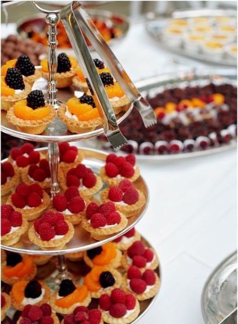 a stylish polished metal tiered dessert stand is all you need for a chic wedding, whether it's a vintage or a modern one