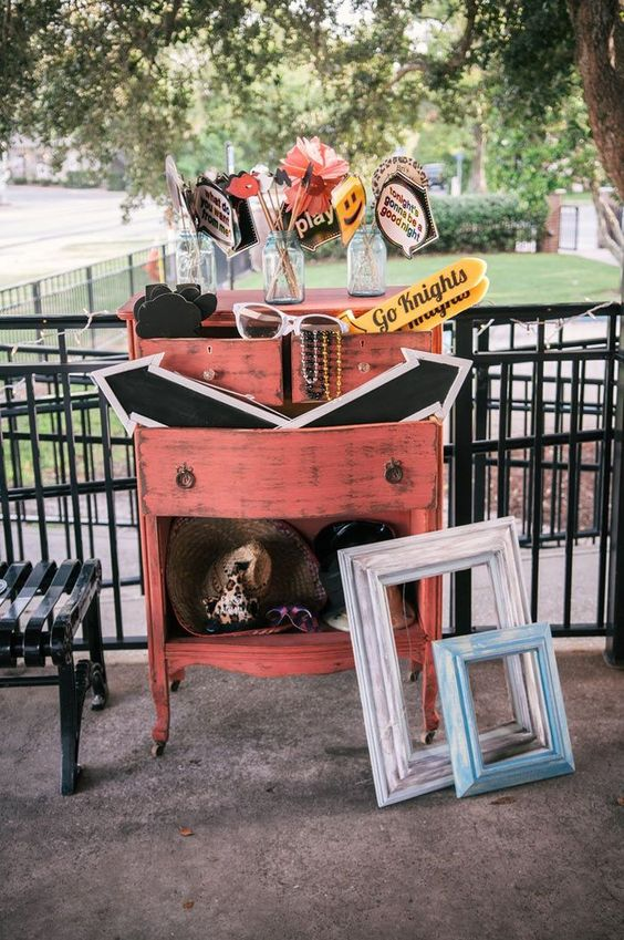 a vintage dresser with colorful and whimsy props and vintage frames is what you need for your photo booth