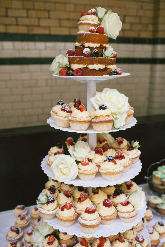 a white scallop edge wedding dessert stand is a great option for a modern or vintage wedding