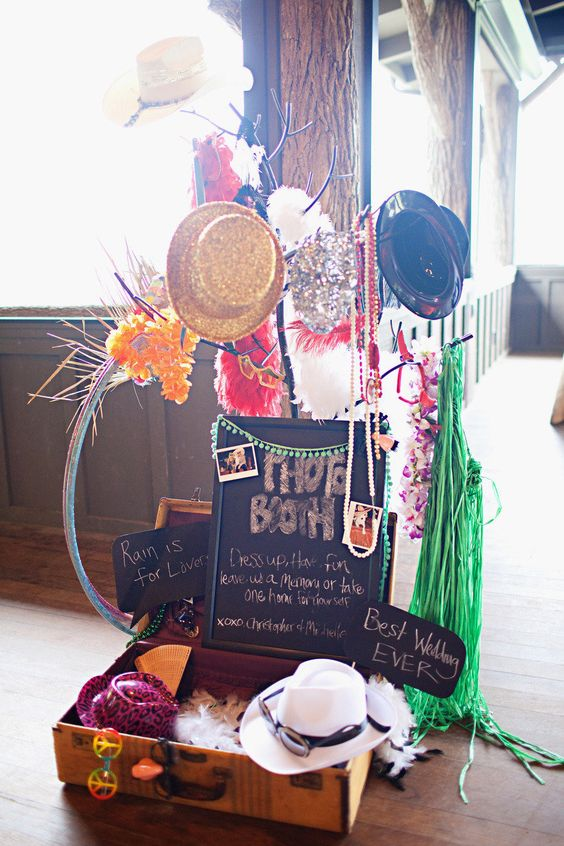 a whole photo booth prop arrangement - glitter hats, garlands, hats, glasses, chalkboard signs and more