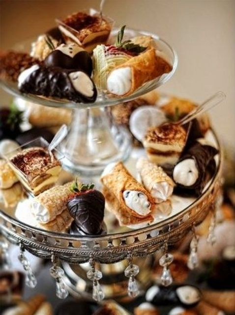 an elegant glass and mirror tiered dessert stand with hanging crustals is amazing for a refined vintage or modern wedding
