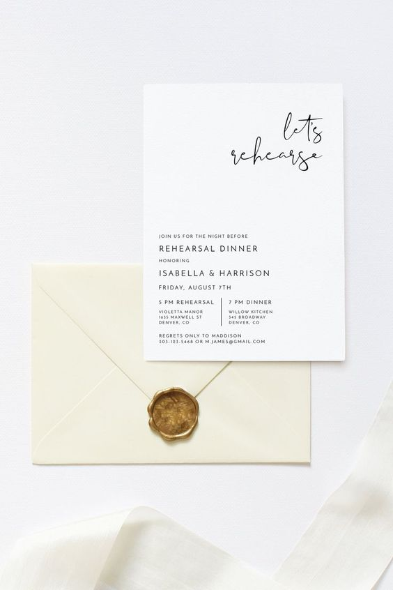 an ultra-modern and minimal rehearsal dinner invitation with calligraphy and an ivory envelope