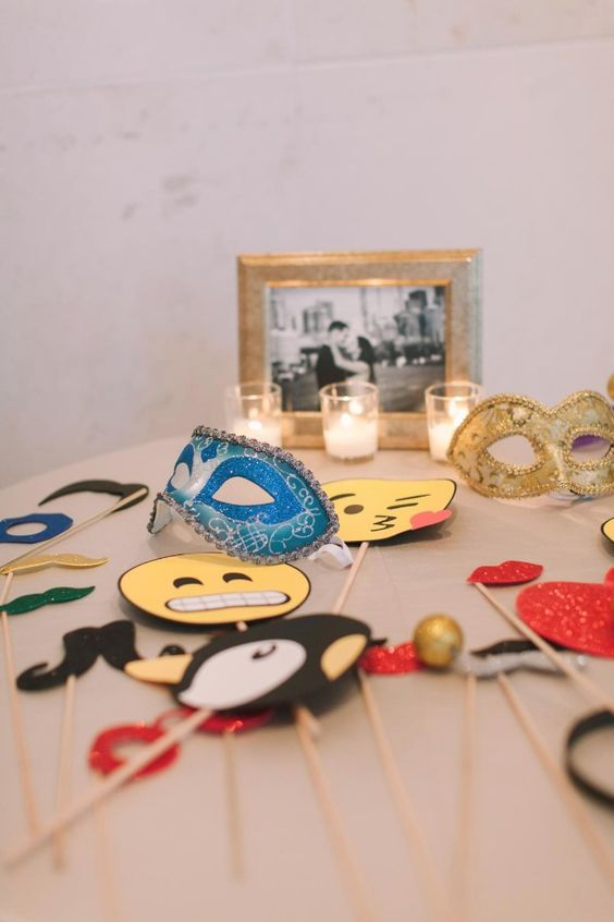 bright and fun wedding photo booth props - masks, smiles, moustaches and kisses