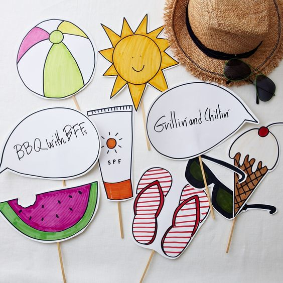 colorful and funny wedding photo booth props - sun, watermelon, flipflops, the sun and others for a summer wedding
