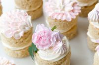 delicious mini layer bridal shower cakes topped with fresh blooms and meringues