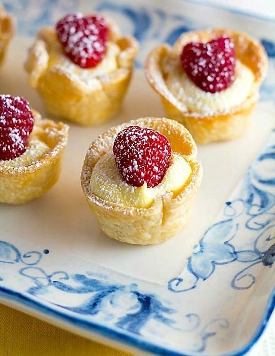 mini lemon tartlets topped with raspberries