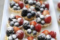 tartlets with berries – blackberries, blueberries, strawberries and sugar powder