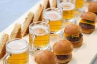 a cool fast food tray with beer mugs, hot sandwiches and mini burgers is great for a modern wedding