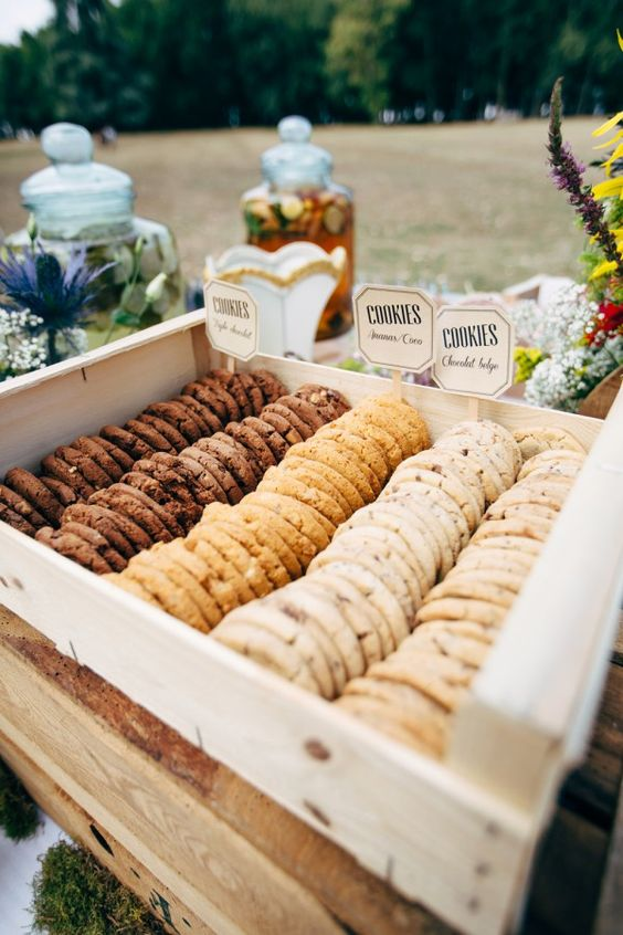 a crate with various types of cookies, which you can DIY, is a lovely wedding dessert bar idea
