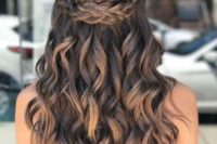 a gorgeous wavy half updo with a Celtic braid element on top is a stunning idea to show off your locks