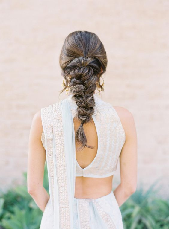 a large and thick braid with a bump on top and some locks down is always a good idea to go