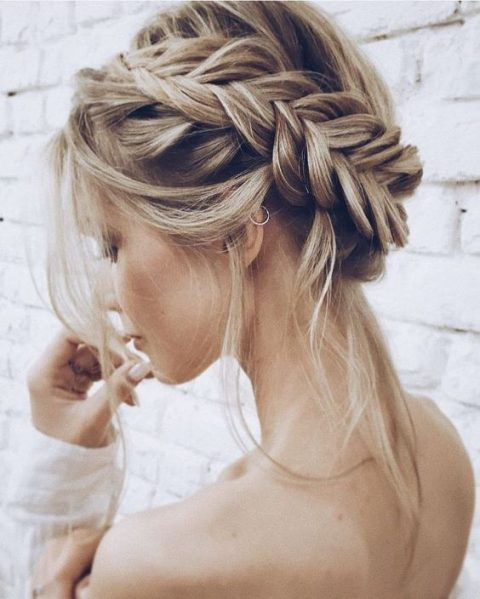 a loose fishtail updo with locks down is a chic and sexy idea for a boho or rustic bride