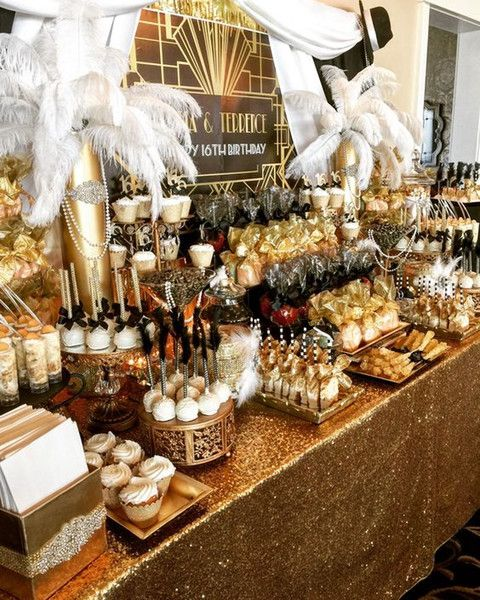 a luxurious art deco candy bar with lots of sweets, feathers, beads and embellishments plus a gold sequin tablecloth