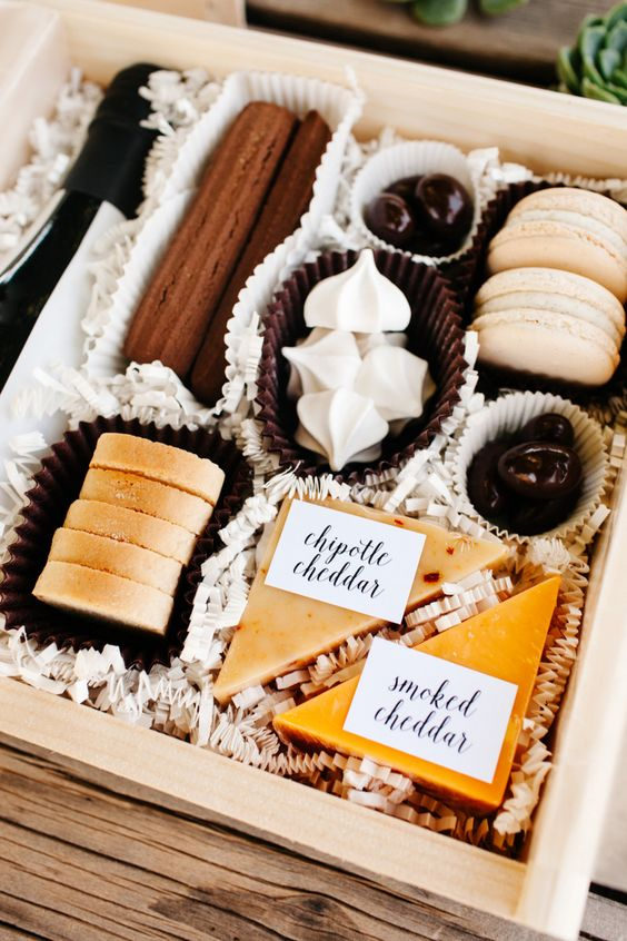 a midnight snack box with two types of cheese, meringues, cookies, macarons, chocolate and eclairs