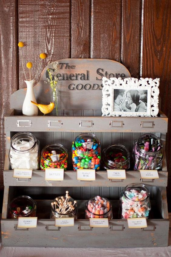 a mini candy bar made of a vintage wooden stand and jars with candies and tags, a photo and billy balls