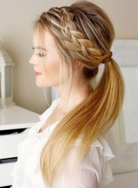 a ponytail with a bump, halo braid and some bangs down looks pretty, modern and rustic