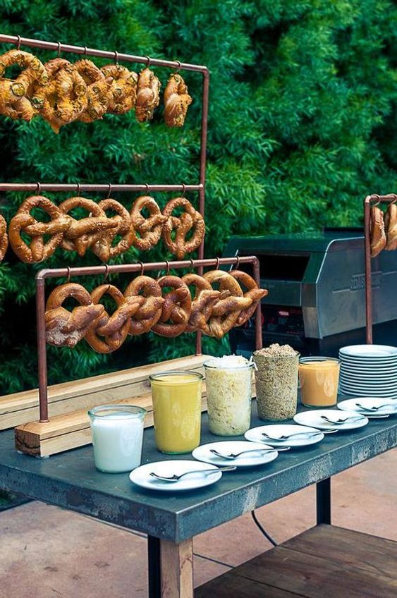a pretzel stand with various kinds of dip and sauce is a lovely idea for a relaxed and informal dinner