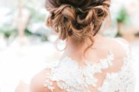 a wavy updo on medium length hair with a bump on top is a very elegant and refined idea