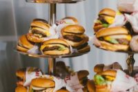 a wedding buger bar is a timeless and casual idea for a modern wedding, wrap them in paper for more comfort