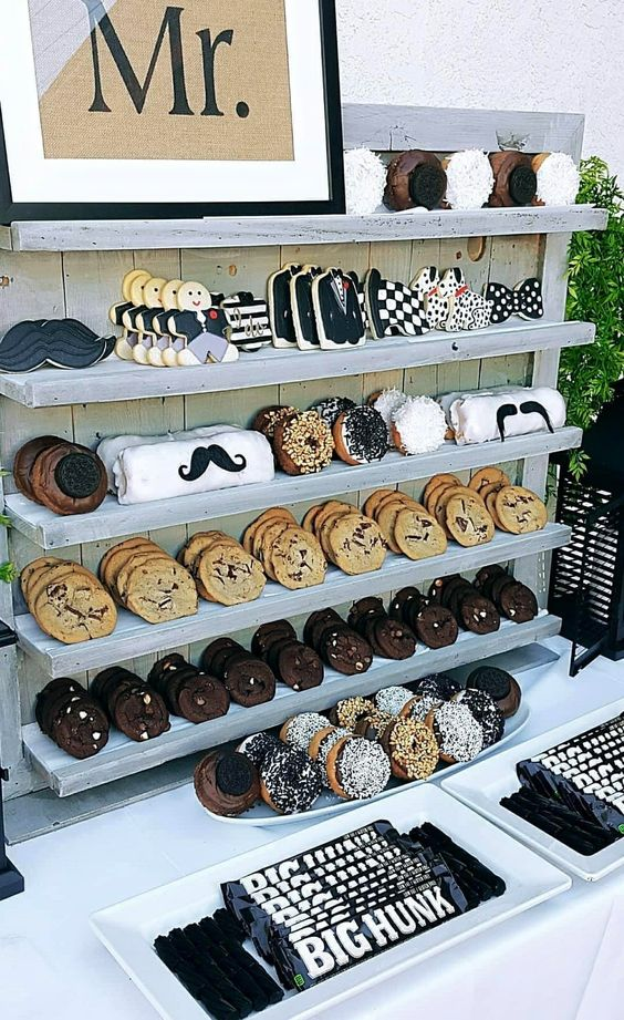 a wedding cookie bar style as a men's one, with fun sweets that are styled for guys