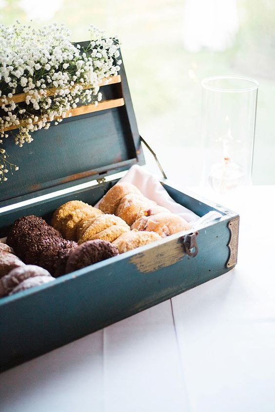 an elegant blue vintage box with tasty glazed donuts and baby's breath for stylish serving