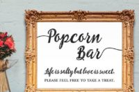 an elegant popcorn bar sign in a frame is a chic idea for vintage and refined wedding