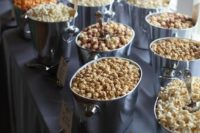 an elegant popcorn bar with silver tubs and labels is a fit for any wedding, the tubs are very elegant