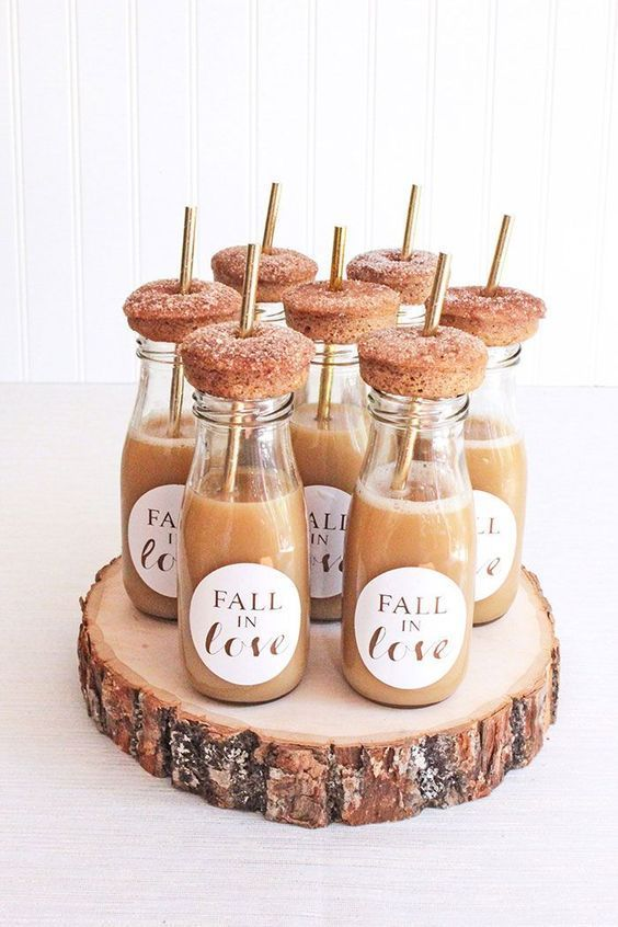 apple cider bottles and fresh donuts on top are nice wedding favors or late night snacks