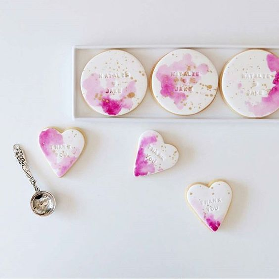 beautiful watercolor pink and gold wedding cookies are a great idea to personalize your desserts