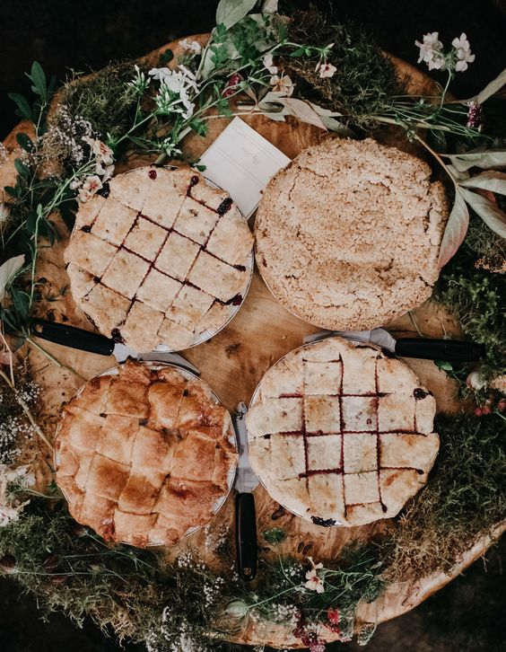 cozy homemade pies with berries and fruits are idea for serving them as desserts at a bbq rehearsal dinner
