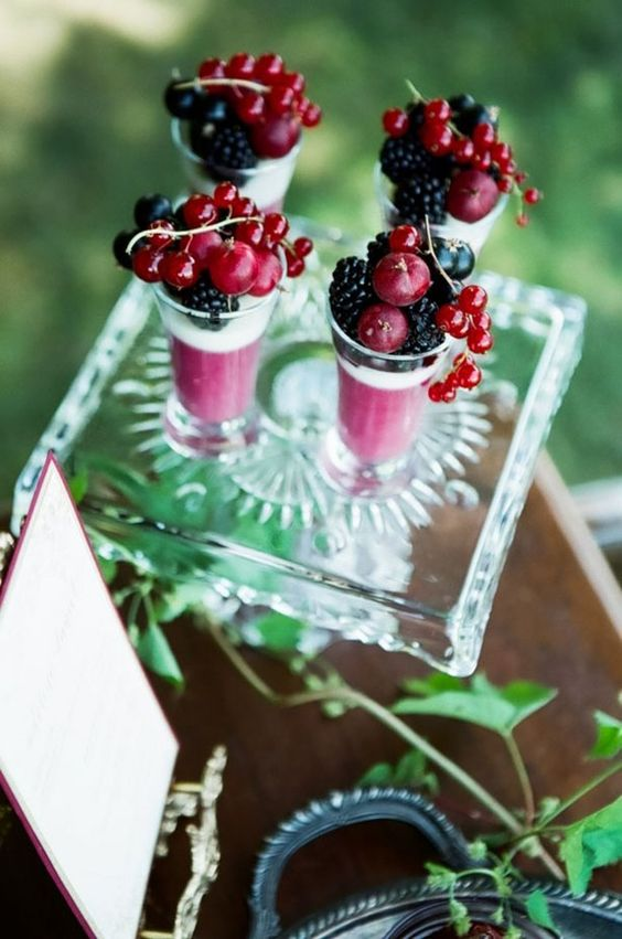 fresh berry parfait topped with berries - blackberries and currant of various types for a summer wedding