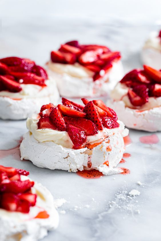 mini cheesecake pavlovas with fresh strawberries are delicious for a spring or summer wedding