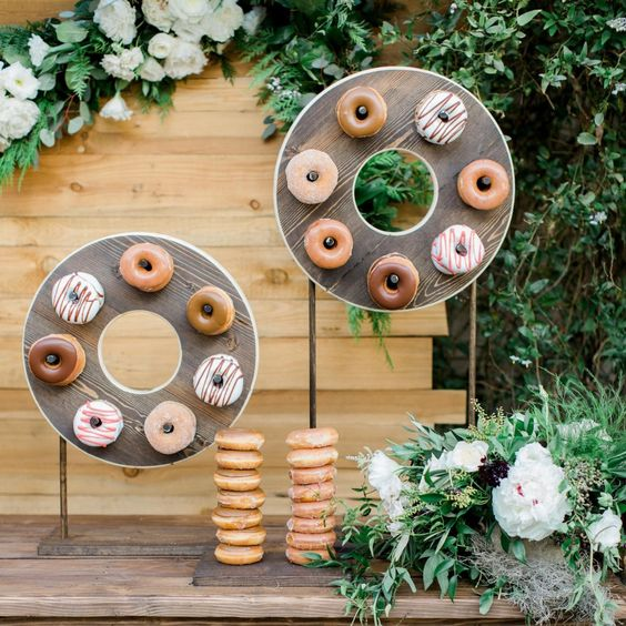 mini donuts of plywood on stands as donut displays and donuts on holders for a modern wedding or bridal shower