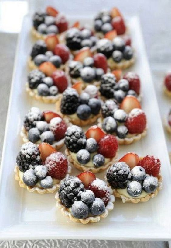 mini tartlets with custard, blackberries, blueberries and strawberries plus sugar powder for a summer wedding