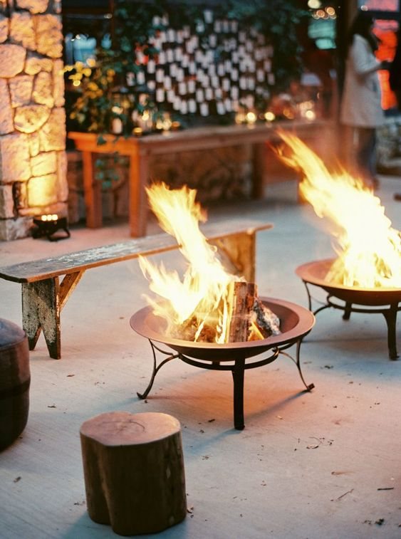 place several fire pits for gathering, getting to know each other and making s'mores at your rehearsal dinner