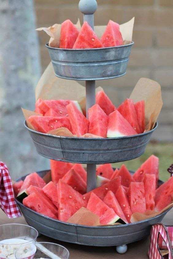 serve fresh watermelon slices on a tin stand to make everyone happy and refreshed, this is a true summer treat