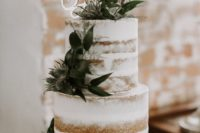 a chic naked wedding cake with greenery, thistles, a chic gold topper for a modern wedding