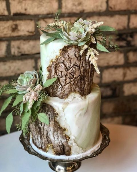 a gorgeous woodland wedding cake with greens, bark, fresh succulents and greenery looks really wow