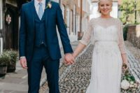 a neutral sheath wedding dress with lots of embellishments, long sleeves and an illusion neckline for an effortlessly chic 20s look
