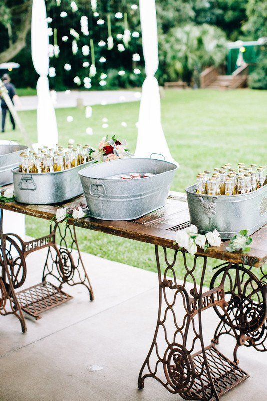 a refined vintage wedding drink bar of a Zinger machine stand and some galvanized bathtubs for storing drinks is a very cool idea to rock