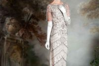 a romantic 1920s fully embellished wedding dress, with short fringed sleeves and tall gloves