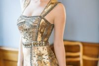 a shiny gold embellished mermaid wedding dress with thick straps and a glam headpiece for a Gatsby-inspired look