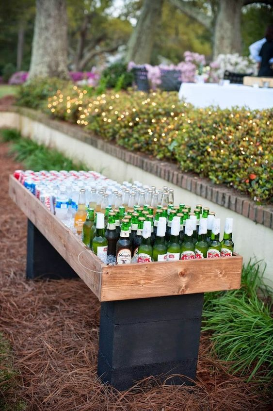 a simple alternative to a usual wedding bar, a wooden stand with lots of cans and bottle, everyone can take whatever they want