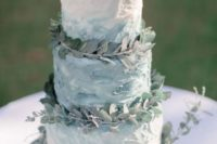 a textural ombre buttercream wedding cake topped with eucalyptus is a delicate and breezy idea for a coastal wedding