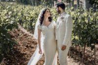 an art deco silk wedding dress with a draped bodice and a V-neckline plus a long veil plus statement jewelry