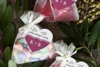 assorted candies in packs with tags are a timeless favor idea for rehearsal dinners and weddings
