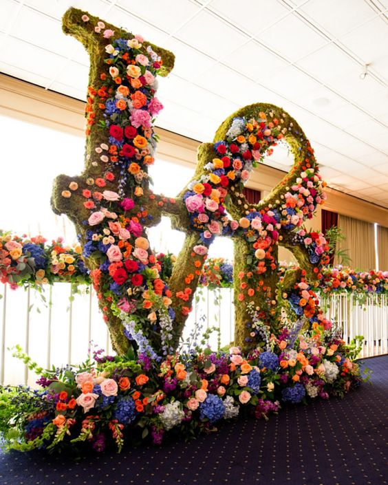 awesome oversized letters covered with moss and all colors and kinds of blooms look just jaw-dropping